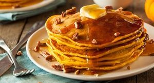 Homemade Pumpkin Pancakes with Butter Pecans and Maple Syrup